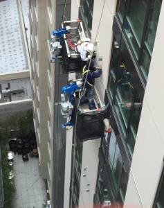 Rigging NYC Midtown hotel - setting brackets for exterior vent over 20 floors