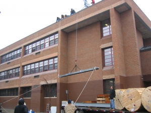 High School, Newark NJ - installed and operated swing arm hoist to pick steel beams for cell tower installation.