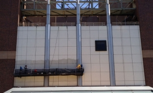 Metal panel cleaning at John Jay College using suspended scaffolding