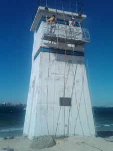 painting with suspended scaffold - Observation tower at Breezy Point, Queens