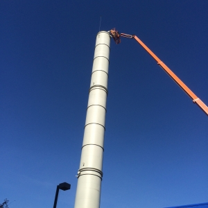 Smoke stack pressure washing
